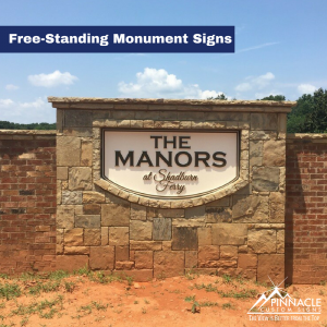 Free-standing monument sign for The Manors subdivision.