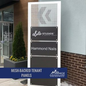 Mesh, free standing directional sign