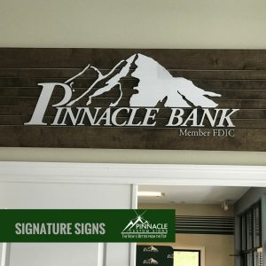 wood, pvc, and brushed aluminum sign