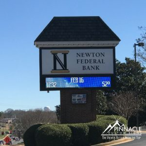 Provide useful information, like this sign from Newton Federal Bank