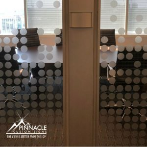 Vinyl graphics for a glass walled meeting room adds a branded feel to the room.