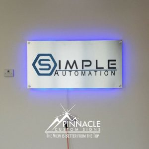 Laser etched metal sign for Simple Automation