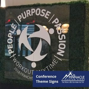 acrylic sign with the conference theme - People, Purpose, Passion