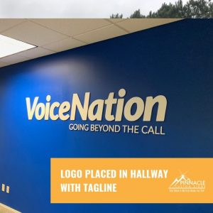 logo sign with tagline in hallway for Voice Nation